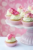 stock photo of sugarpaste  - Pink flower cup cakes on a cakestand - JPG