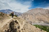 stock photo of himachal pradesh  - Photographer taking photos in Himalayas mountains - JPG