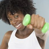 stock photo of weight lifter  - Young woman lifting weights - JPG