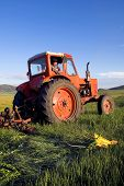 picture of mongolian  - Mongolian farmer driving his tractor on the field - JPG