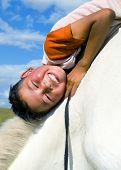 stock photo of mongolian  - Mongolian boy with his horse - JPG