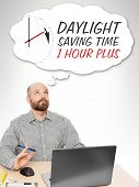 stock photo of daylight-saving  - An image of a handsome business man thinking about the daylight saving time - JPG