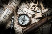 vintage  still life with compass,sextant spyglass and old map.map used for background is in Public domain. Map source: Library of Congress. Belgium Year: 1570 Author Abraham Ortelius 1527-1598