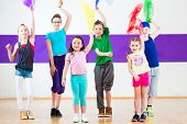 picture of zumba  - Children dancing modern group choreography with scarfs - JPG