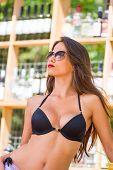 Young woman enjoying the summer at beach bar