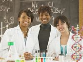 African female science teacher with female students