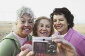 Group of senior women taking a photograph of themselves