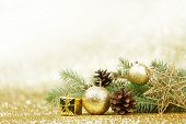 Christmas card with fir and decor on glitter background