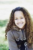 image of braces  - Young African girl with braces smiling - JPG