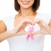 healthcare, medicine and breast cancer concept - woman with pink cancer ribbon