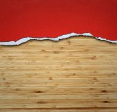 Ripped paper on wood, space for copy