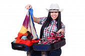 Woman trying to pack too much isolated on white