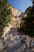Ols stone stairs leading up to a medieval house in Rab, Croatia