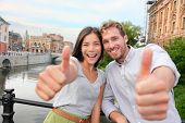 image of scandinavian  - Thumbs up couple happy in Stockholm - JPG