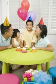 picture of nuclear family  - Asian boy celebrating birthday with family - JPG