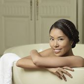 Portrait of Asian woman in bathtub