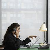 Indian businesswoman talking on telephone