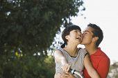 Portrait of Asian couple kissing