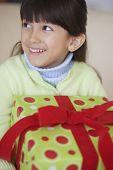 Hispanic girl holding gift