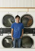 Asian man in Laundromat