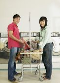Asian couple in laundromat