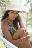 African American woman sitting in hammock