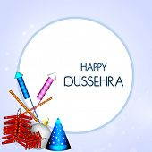 picture of dussehra  - Stylish text of Happy Dussehra in circle with colourful crackers on blue background - JPG
