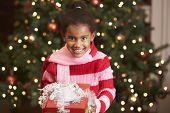 African American girl holding Christmas gift