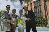 Hispanic businesspeople holding gifts