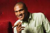 African man holding cigar