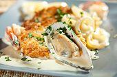 Seafood Pancake with Tiger Shrimps, Calamari, Mussels and Cream Sauce