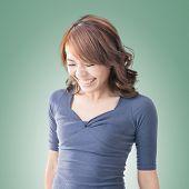 Shy Asian girl smiling, closeup portrait.