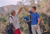 Multi-ethnic men on golf course
