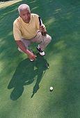 Senior African American man on golf course