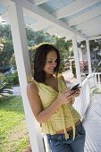 Hispanic woman dialing cell phone