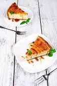 Cheese cake in plate on grey wooden background