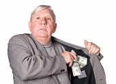 Elderly Man Puts Money In An Internal Pocket Of A Jacket