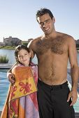 Hispanic father and daughter next to swimming pool