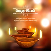stock photo of diwali  - illustration of burning diya on Diwali Holiday background - JPG
