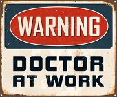 Vintage Metal Sign - Warning Doctor At Work - Vector EPS10. Grunge effects can be easily removed for a cleaner look.