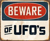 Vintage Metal Sign - Beware of UFO's - Vector EPS10. Grunge effects can be easily removed for a brand new, clean design.