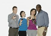 Two multi-ethnic couples drinking wine