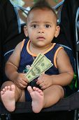 African American toddler Holding Money