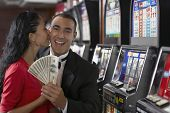 Hispanic couple holding money