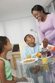 picture of pre-adolescent child  - African American mother and children at breakfast - JPG