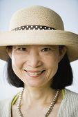 Asian woman wearing straw hat