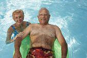 Multi-ethnic senior couple in swimming pool
