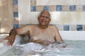 Senior Mixed Race man in hot tub