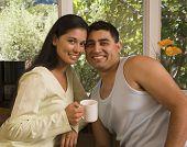 Multi-ethnic couple touching heads