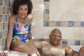 Multi-ethnic senior couple in hot tub